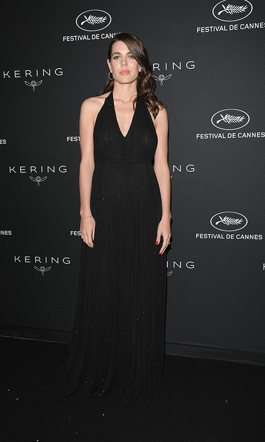 Sleek and simple was the name of the game for the pregnant royal at the Cannes Film Festival in May, where she attended the Women in Motion Awards Dinner wearing a black halter gown and hoop earrings. Charlotte added a peach lip and her tresses pulled to one side. 