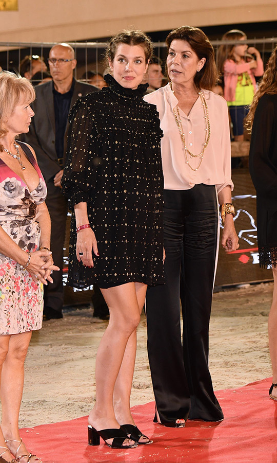 The expectant royal dressed her bump in a breezy YSL dress featuring a pie-crust collar and black heeled sandals at the Longines Global Champions Tour of Monaco, which she attended with Princess Caroline. The mother-daughter duo looked chic as ever as they presented the winner with the Longines ProAm Cup Monaco 2018. 