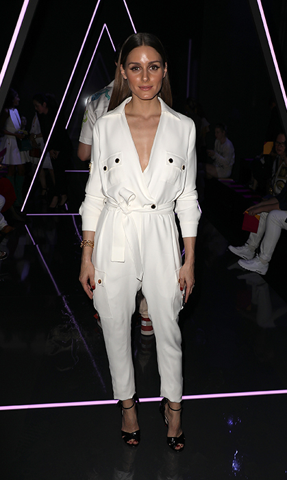 Olivia Palermo dusted off her best white jumpsuit for the Ralph & Russo show.