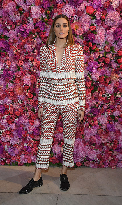 Coordinated pantsuits are all the rage this season, and doesn't Olivia Palermo know it! The fashionista showed off her best look at the Schiaparelli Haute Couture show, standing against a beautiful floral backdrop.