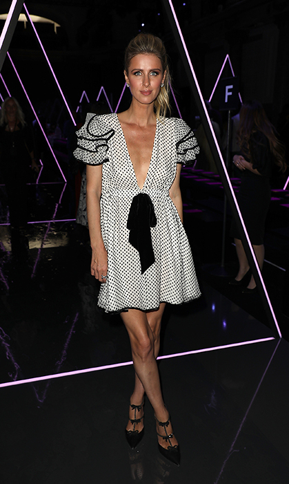 Nicky was also back out on the town that evening, donning a feminine dress for the Ralph & Russo catwalk show.