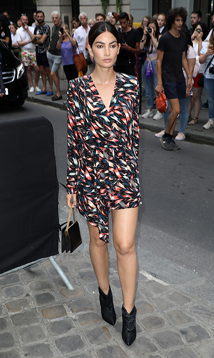 Lily Aldridge arrived to the Givenchy Haute Couture show on July 1 in a cute minidress and black boots.