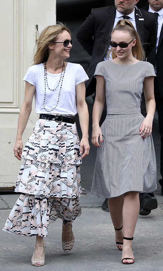 French model and actress Vanessa Paradis shared a laugh with her daughter Lily-Rose Depp as they left the Chanel show. Both beauties have modelled for the brand