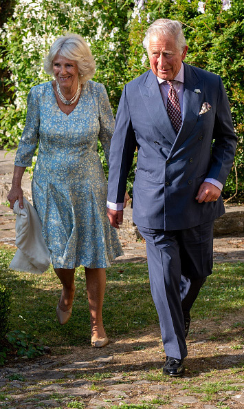 Camilla and Prince Charles enjoyed a romantic stroll as they attended an evening of music and drama at their Welsh home in Llandovery on July 3.