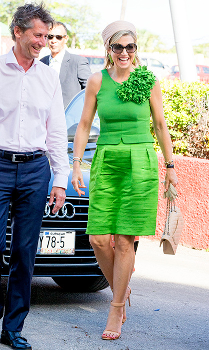 Queen Máxima's outfit made us green with envy! The royal stunned in the bright colour while visiting Excel Arts Academy on July 2.