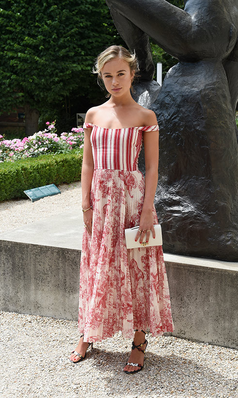 Lady Amelia Windsor was a vision at the Christian Dior presentation during Paris Haute Couture Fashion Week on July 2, wearing one of the label's stunning gowns. The red-and-white design featured a striped bodice with off-the-shoulder straps and a pleated, horse-print skirt. The 22-year-old finished off her look with a white clutch and strappy sandals, her blond locks in a soft updo and her makeup simple and natural.