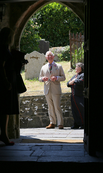 Prince Charles looked inside St. Gwenog's Church.