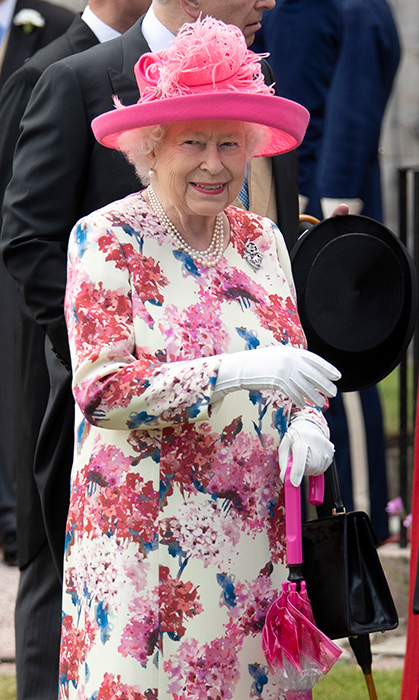 The Queen loves a good floral, and she showed off one of her best looks on July 4 for the the annual garden party at the Palace of Holyroodhouse in Edinburgh. She paired her dress with a pink hat and matching umbrella for the occasion.