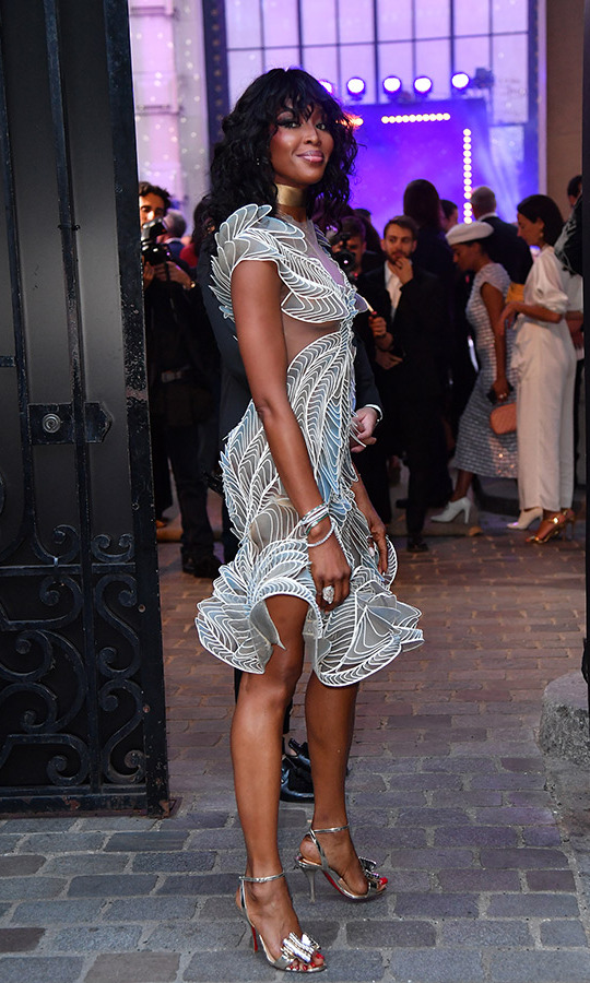 Naomi Campbell was out of this world in an Iris Van Herpen dress, which she paired with a gold collar, diamond baubles and silver sandals at the Vogue soiree.