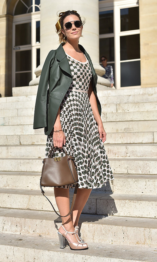 Mandy Moore was retro chic as she attended the Fendi show in a patterned dress with a full skirt, a green leather jacket and a big gold bow in her hair.