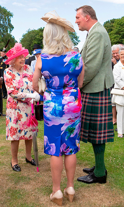 Queen Elizabeth II had a happy meeting with former Scotland ruby union player Doddie Weir and his wife Kathy. Her Majesty was hosting the annual garden party at the Palace of Holyroodhouse in Edinburgh on July 4.