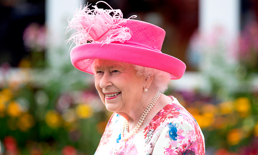 The Queen showed off one of her best summery looks – a beautiful pink floral dress, paired with a pink hat and two strands of pearls.