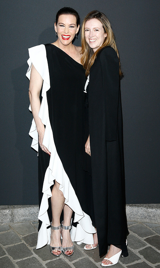 Liv Tyler attended the Vogue Paris Foundation fete with none other than Meghan Markle's wedding gown designer Clare Waight-Keller - and both looked chic and stunning in monochrome ensembles. 