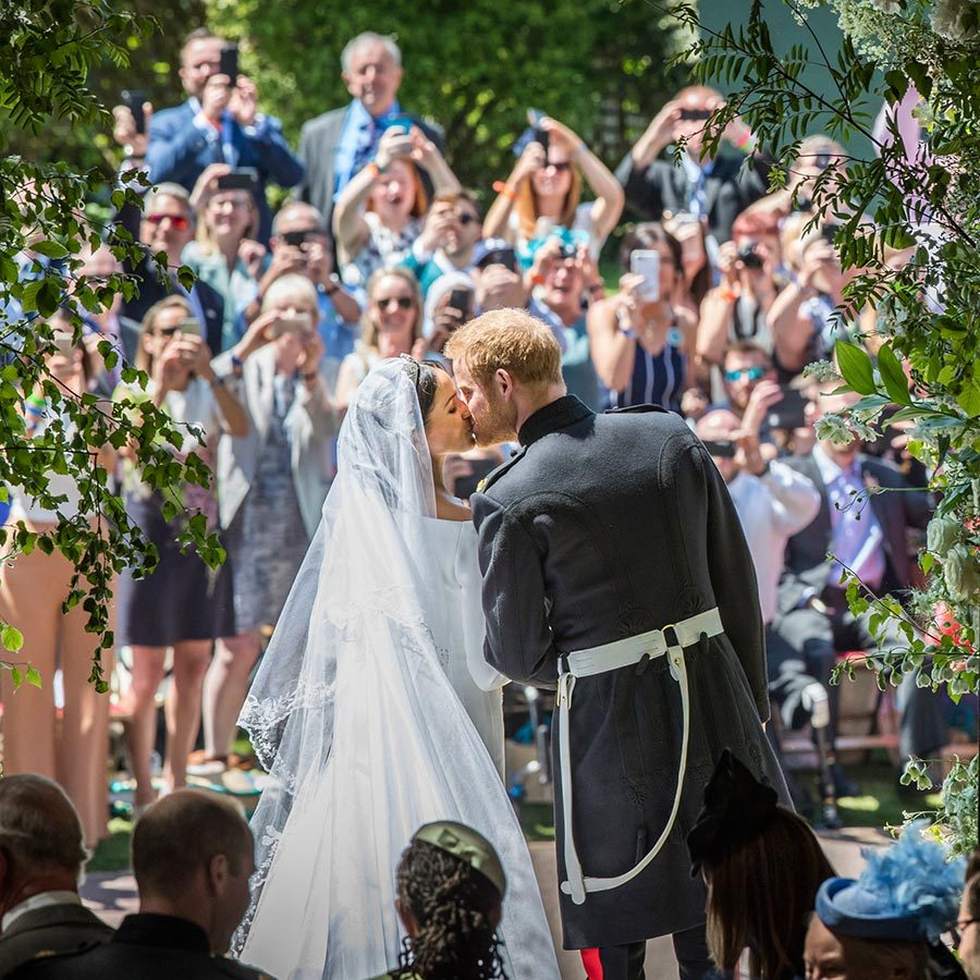 A fairytale ending! Prince Harry and Meghan shared a romantic kiss as they left St. George's Chapel as husband and wife. The sweet moment seen by millions will go down in history.
