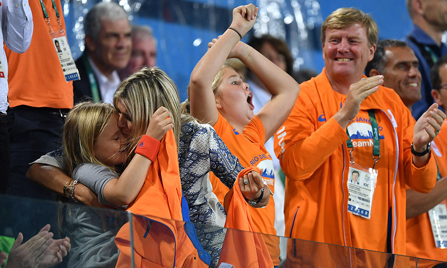 Queen Maxima of the Netherlands gave daughter Princess Ariane a celebratory smooth as the duo cheered Team Netherlands alongside Princess Catharina-Amalia and King Willem Alexander during the Women's gold medal hockey match as part of the 2016 Rio Olympics.