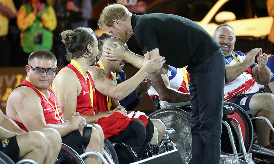 Prince Harry planted one on a Norwegian wheelchair rugby player after presenting him with a gold medal during the Toronto Invictus Games in 2017. 