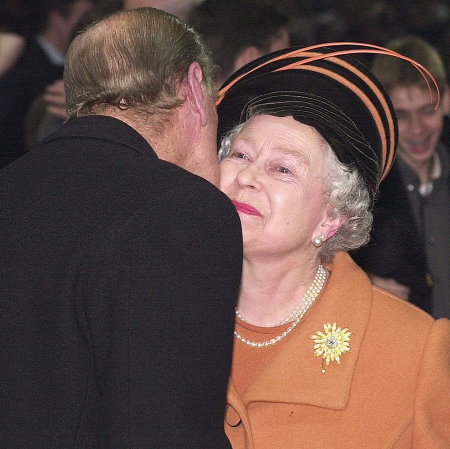 In a very rare display of affection, Prince Philip laid a kiss on his wife of many decades, Queen Elizabeth II, during the new year's eve celebration at London's Millennium Dome in 1999. 