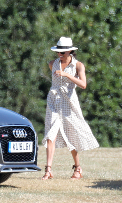 The Duchess of Sussex got back to her style roots with a gingham summer dress by Soshanna, a Panama hat, sunglasses and a pair of Sarah Flint Grear sandals for a day with friends Serena Williams and Alexis Ohanian. The trio were at the Audi Polo Challenge to watch Prince Harry play!