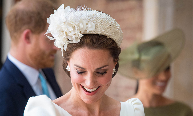 The Duchess of Cambridge wore an Alexander McQueen dress with a Jane Taylor headpiece featuring floral embellishments. She has worn this hue to all three of her children's christenings, perfectly coordinating with her baby's robe.
