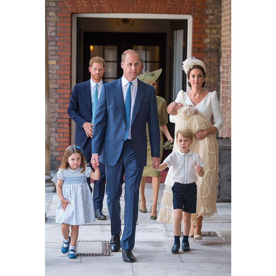 "The Cambridges made their first appearance as a family of five at St. James's Palace on July 9, where <a href=""/tags/0/prince-louis/"">Prince Louis</a> was christened in the Chapel Royal. <a href=""/tags/0/prince-william/"">Prince William</a> held the hands of his older children as <a href=""/tags/0/kate-middleton/"">Kate</a> doted on their newest member. <a href=""/tags/0/prince-harry/"">Prince Harry</a> and <a href=""/tags/0/meghan-markle/"">Meghan</a> walked behind them as they approached the <strong>Archbishop of Canterbury, Justin Welby</strong>, who performed the ceremony. He tweeted his excitement earlier in the day, saying, ""I'm delighted and privileged to be christening Prince Louis today – a precious child made in God's image, just as we all are.""