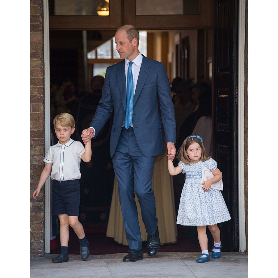 Prince William held onto Prince George and Princess Charlotte as the perfectly coordinated trio left the Chapel Royal. Prince George wore a white short-sleeved shirt with navy shorts, his dad looked dapper in a navy suit and blue tie and little Charlotte donned a blue and white dress, blue headband with a bow and Mary Jane shoes.