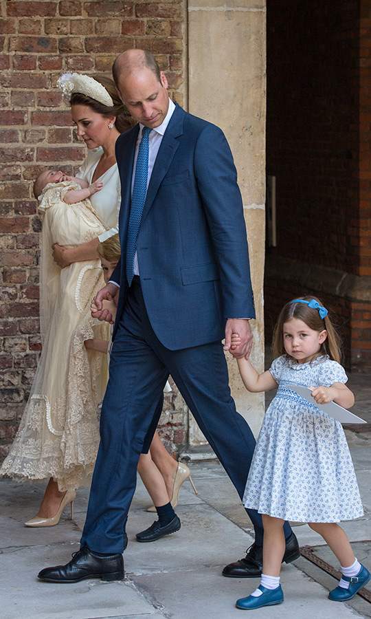 Though she's an expert waver at this point, Princess Charlotte's hand was full holding a paper from the christening.