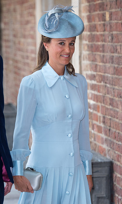 Pippa showed off her small baby bump in a beautiful powder blue shirt dress for the christening of her new nephew, Prince Louis.
