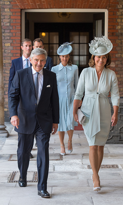 Proud grandparents Michael and Carole Middleton were beaming, too. Duchess Kate's mom looked stunning pale mint green dress and matching hat, while her father looked handsome in a suit.