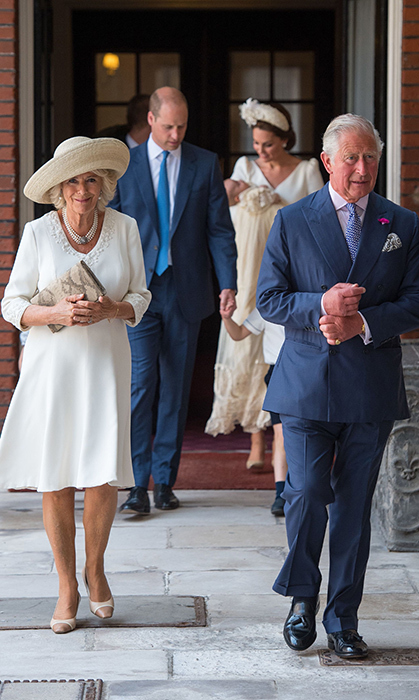 Camilla, Duchess of Cornwall, and Prince Charles arrived just ahead of the Cambridge family. Camilla looked summer ready in a cream dress and wide-brimmed hat.