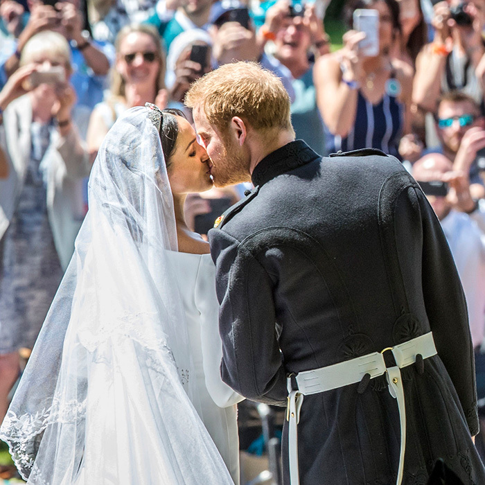 The moment the world was waiting for: their royal kiss! They sealed their royal wedding day with a smooch on the West Steps of St. George's Chapel, Windsor Castle.