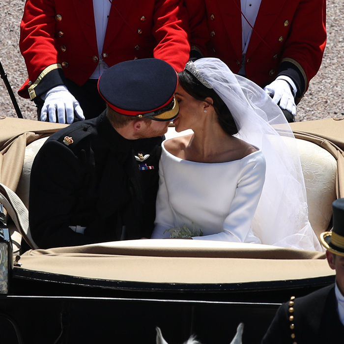 Later on during their carriage processor, they stole another kiss for the crowd.