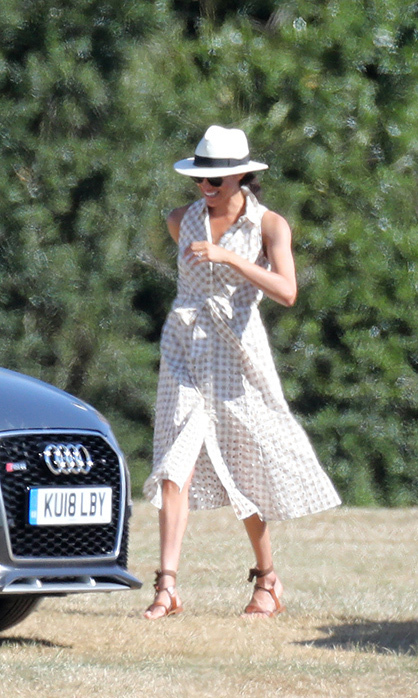 Showing off her personal sense of style, Meghan wore a gingham summer dress and topped her look off with a cute Panama hat for a day out at the Audi Polo Challenge with Serena Williams and her husband, Alexis Ohanian.