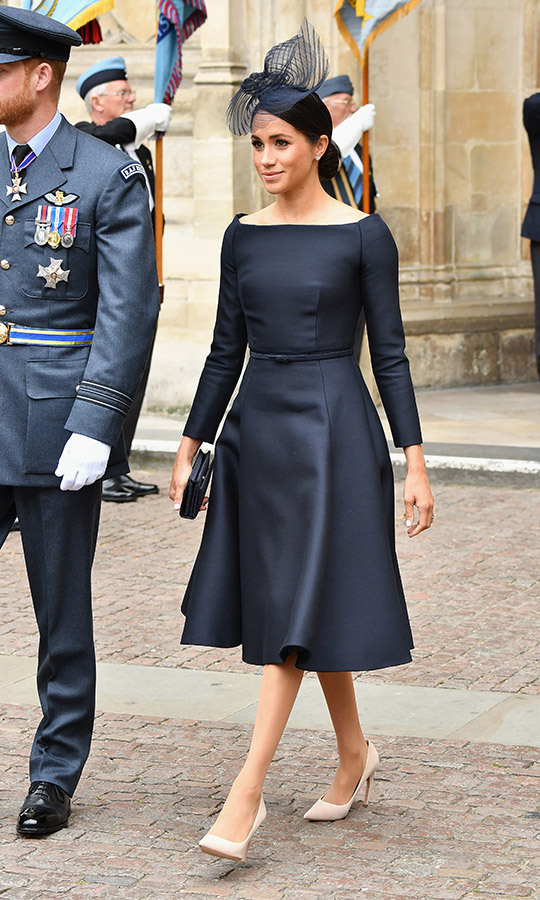 Meghan wore Dior for the first time at the RAF Centenery celebration in London on July 10, 2018, just one day after she stunned in Ralph Lauren at Prince Louis' christening. The custom look featured her now-signature bateau neckline and slim belt, though with a much fuller skirt than her usual fare. She paired the stunning dress with a fascinator by Stephen Jones and Dior accessories - nude heels and a black clutch. 