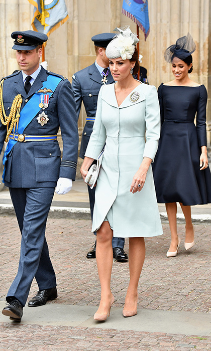 The Duchess of Cambridge wore an Alexander McQueen coat dress, very much like the pale yellow version she donned for Prince Harry and Meghan's wedding but this time in an ice blue. She paired the look with a floral-embellished fascinator by Sean Barrett, a box clutch and nude suede pumps. William looked dapper as ever in his military uniform.