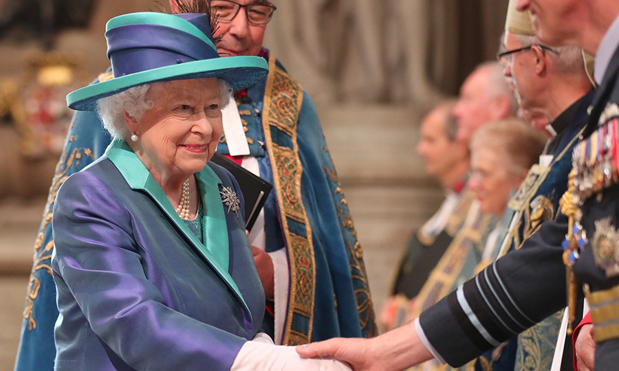 The Queen wore a festive ensemble for the formal ceremony, a purple and green coat dress with matching wide-brimmed hat. Her Majesty missed Prince Louis' christening on July 9 as she was travelling back from Sandringham with Prince Philip, but was certainly in fine form as she celebrated the country's royal air force. 
