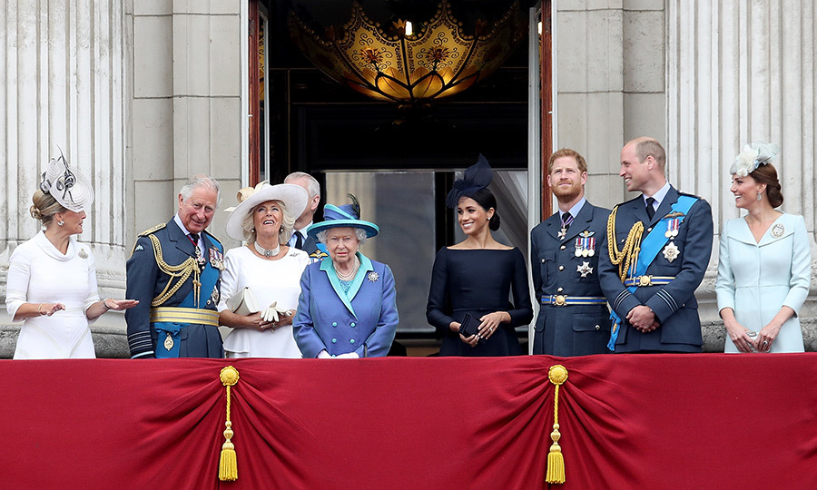 Sophie, Countess of Wessex, Prince Charles, Camilla, Duchess of Cornwall, the Queen, Meghan, Prince Harry, Prince William and Kate were all in high spirits as they gathered on the balcony.