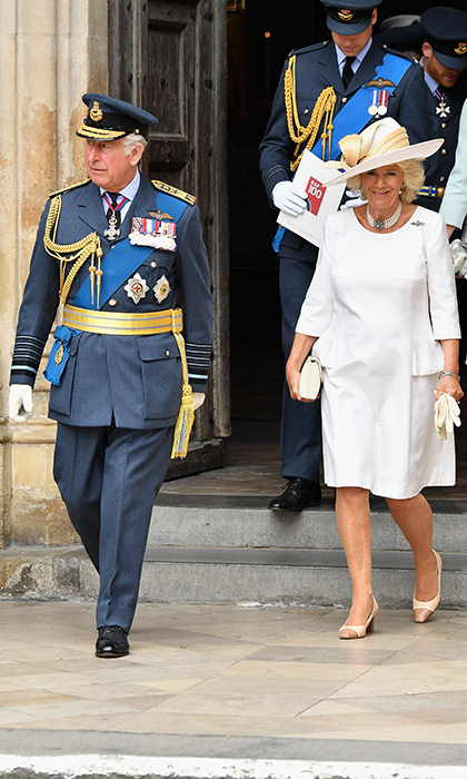 Prince Charles wore his military uniform for the occasion, while his wife Camilla donned head-to-toe white. The Duchess of Cornwall wore a three-quarter-sleeve dress with peplum details on the sides and a wide-brimmed hat along with cream cap-toe shoes and a handbag by the Queen's favourite designer, Launer London. She also carried a pair of cream-coloured gloves.