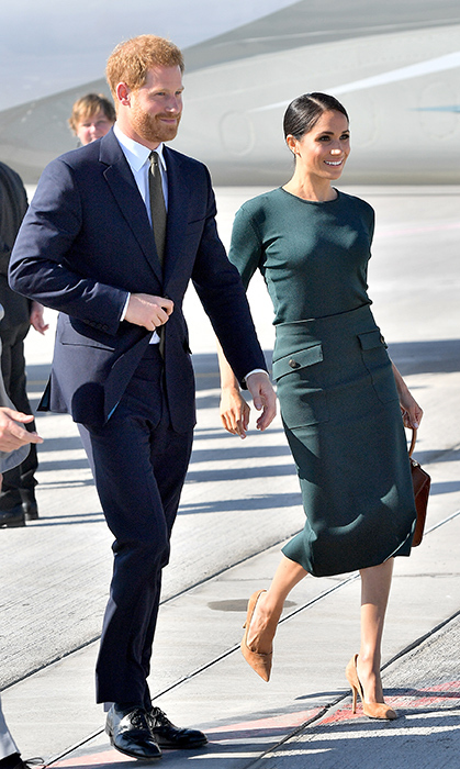 "The Duchess of Sussex made her first overseas trip as an official royal, sided by the love of her life, Prince Harry. While arriving at the Dublin Airport on July 10, 2018, Meghan paid homage to her host country in a deep-green Givenchy blouse and matching 'Patch Pocket' skirt, paired with brown suede pumps, the tan Strathberry Midi Tote handbag and a low chignon. She also wore Vanessa Tugenhaft's ""Precious"" earrings - little clover studs embellished with diamonds!