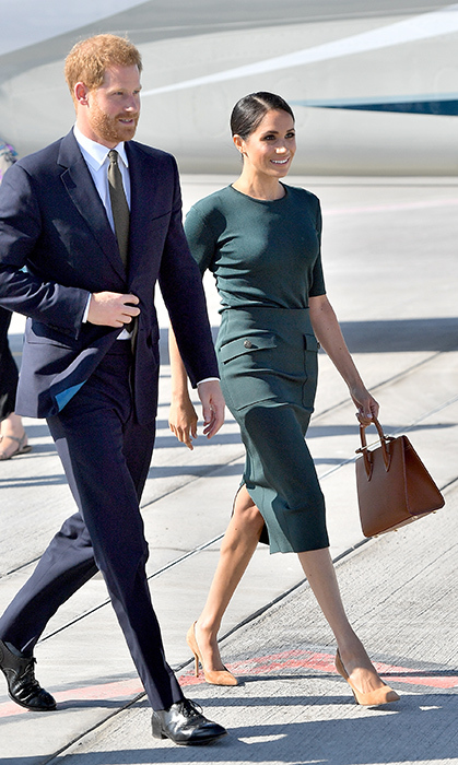 Meghan was the picture of elegance in her coordinating green Givenchy outfit, a Strathberry tote, brown suede heels and a sleek low chignon.