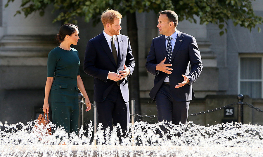 They stopped to chat by a beautiful water fountain.