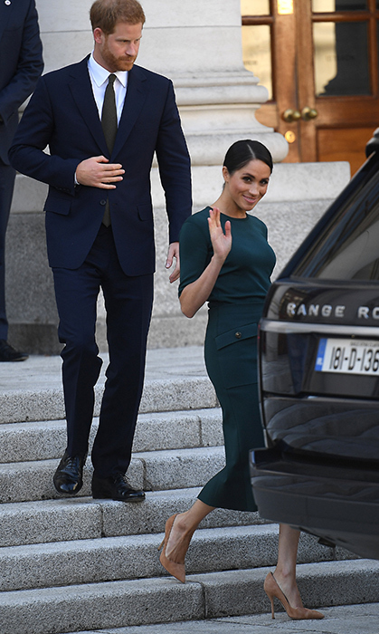 Meghan waved at the cameras before getting into their Range Rover.