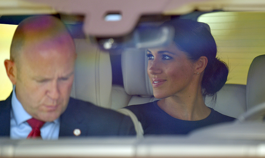 Meghan stared happily out the window as the two drove away from the airport.
