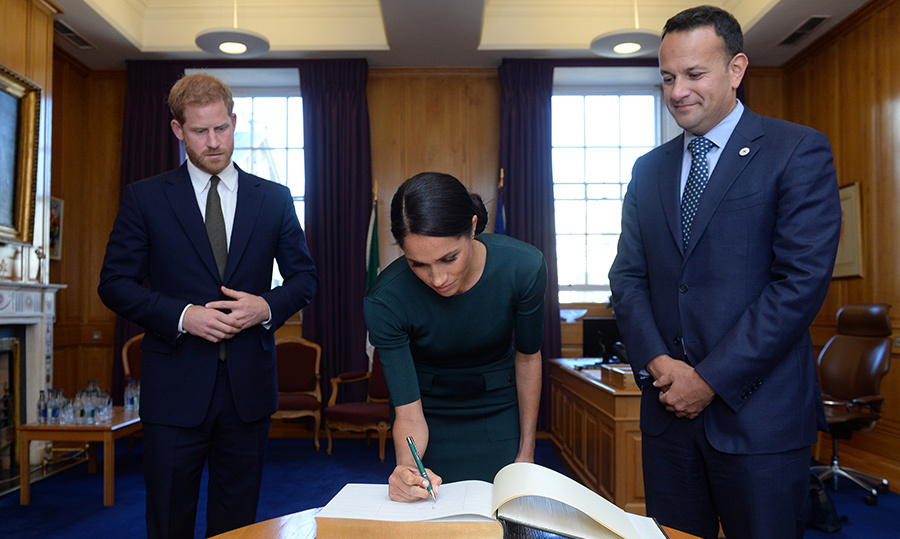 The 36-year-old duchess took a moment to sign the visitor book.