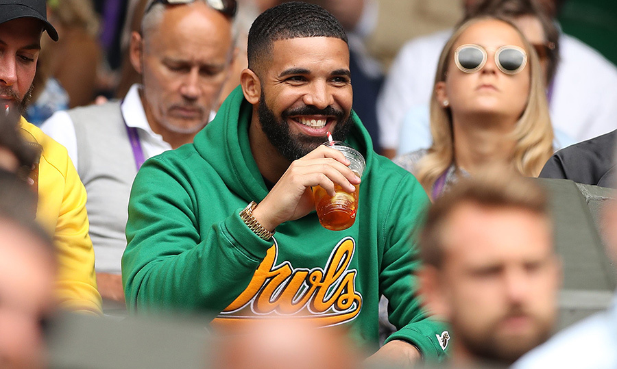Drake was there, too, wearing a bright green hoodie and sipping on a cocktail. He must be enjoying some relaxation time after releasing his latest studio album, <em>Scorpion</em>.