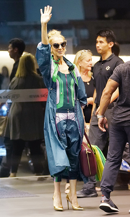 Celine is making Asia her catwalk! She was the picture of cool in this amazing athleisure outfit, paired with metallic gold heels while arriving in Taipei on July 8.