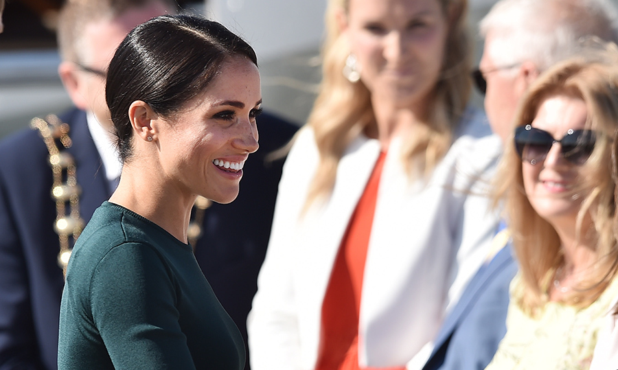 The duchess wore a simple makeup look and her glossy dark hair in a low chignon.