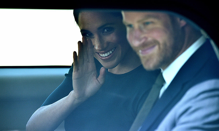 Meghan snuck a wave out the window. 