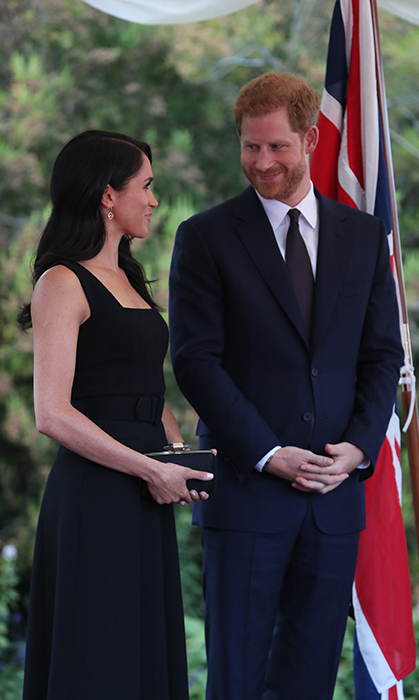 Meghan and Harry have had a busy day! After arriving in Ireland and going for a government building tour, the two had a quick outfit changed and headed for the garden party at Glencairn House in Dublin. Meghan let her hair down, looking beautiful in a simple black Emilia Wickstead dress.