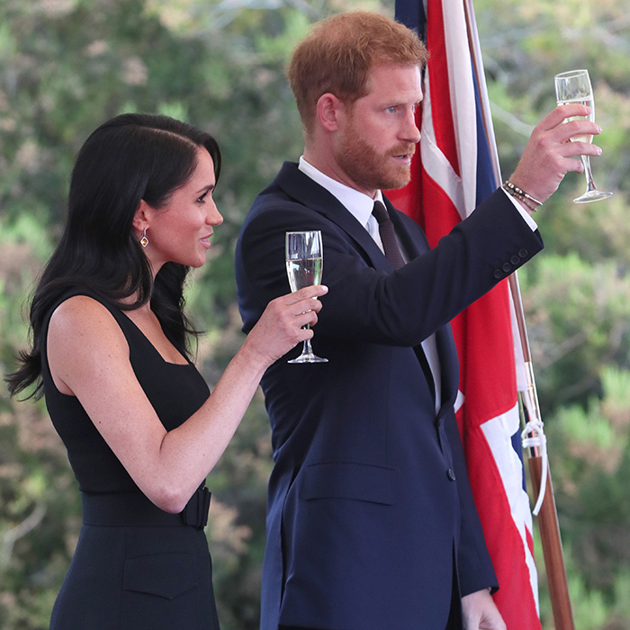 Cheers! The duke and duchess toasted the crowd with some sparkly champagne.