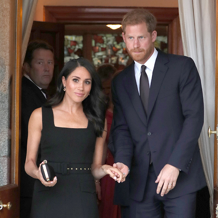 Harry held his wife's hand as they exited Glencairn House.